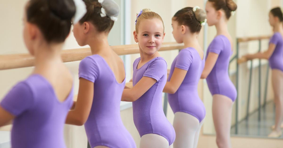 ballerinas in purple leotards